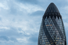 The future of skills in the London Market - Oval shape glass building and blue sky