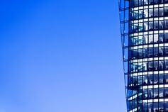 Advanced analytics - the side of a tall building against a blue sky