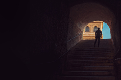 BPR and family business succession planning - man standing on staircase in dark