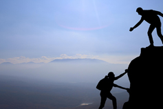 Preparing for business post-Brexit for insurance brokers - silhouettes climbing a rock