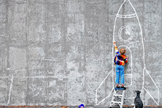 Reimagine challenge - boy drawing rocket on wall