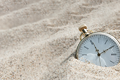 Ten minutes on Tax - photo of a watch in the sand
