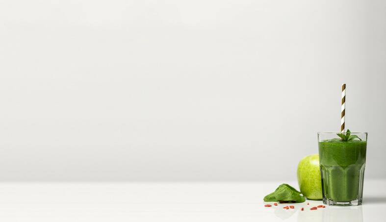 green-apple-and-green-smoothie-against-white-background