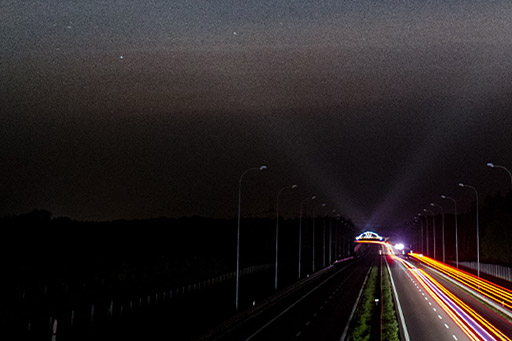 highway-nightview-with-lights-sparks-all-around