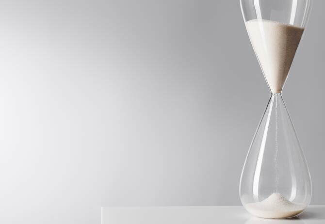 General Insurance Pricing Practices – No Time to Wait - time-hour-glass-against-gray-background