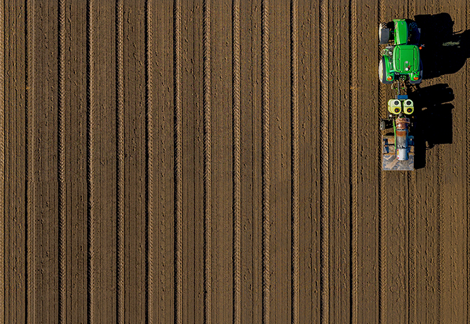 Green tractor in a field