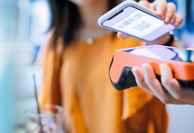 Girl using iPhone for contactless payment