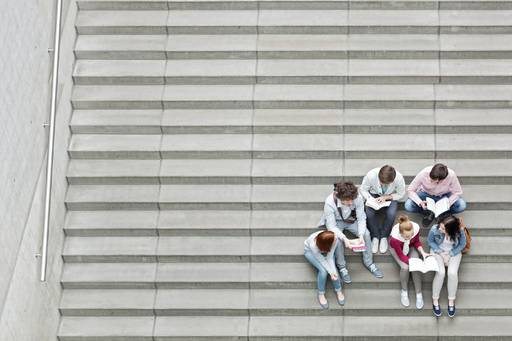 Teens reading on steps