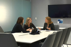 three women in a meeting room