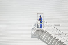 Construction worker with clipboard on stairs
