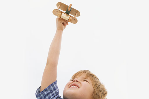 Boy playing with toy plane