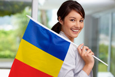 Girl holding romania flag