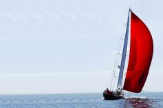 Banking | Red sail boat