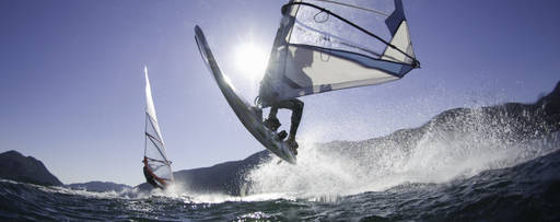 Man jumping with windsurf board