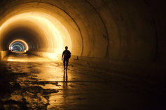 man walking in tunnel
