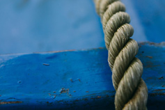 rope on blue wood