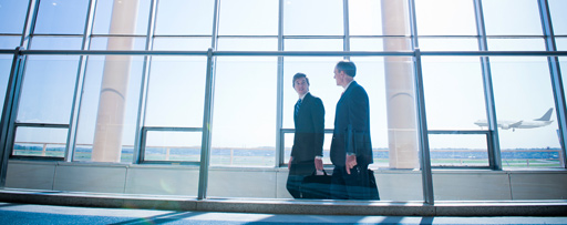two business men walking in airport