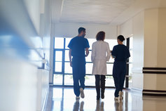 three doctors walking down hall