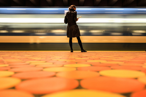 woman standing on subway platform