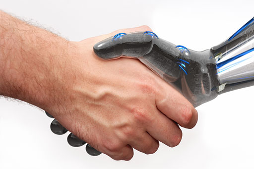 Closeup of human and robot shaking hands