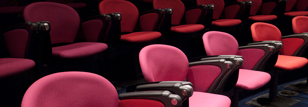 Pink chairs in theatre