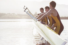 rowers lifting boat