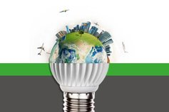 conceptual image of lightbulb and blue globe planet with planes, urban setting and carbon atmosphere around