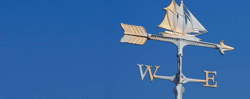 Weathervane on a background of blue sky