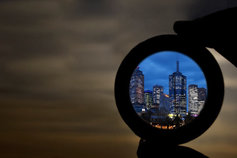 looking at city through binocular glass