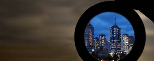 Looking at a city through magnifying glass