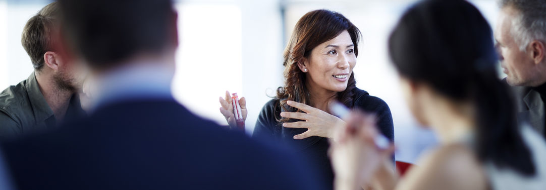 Asian woman in meeting