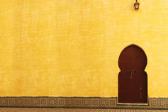 Door on yellow wall