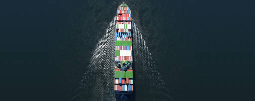 Aerial view of container ship on water