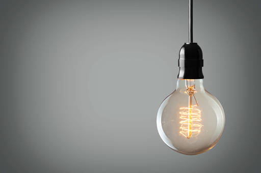 Light bulb over grey background