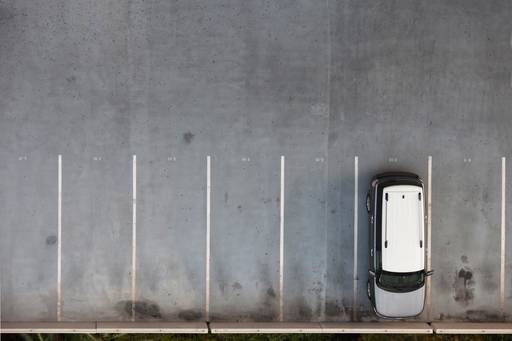 Single car parked in an open air carpark