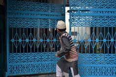 Boy and blue gate