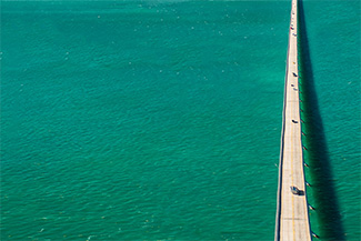Bridge over green ocean
