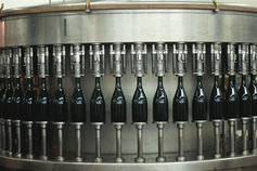 Filling bottles by machine