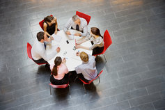Business people having meeting at round table
