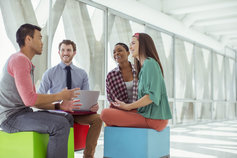 Creative business people meeting on colorful stool