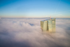 Building above clouds