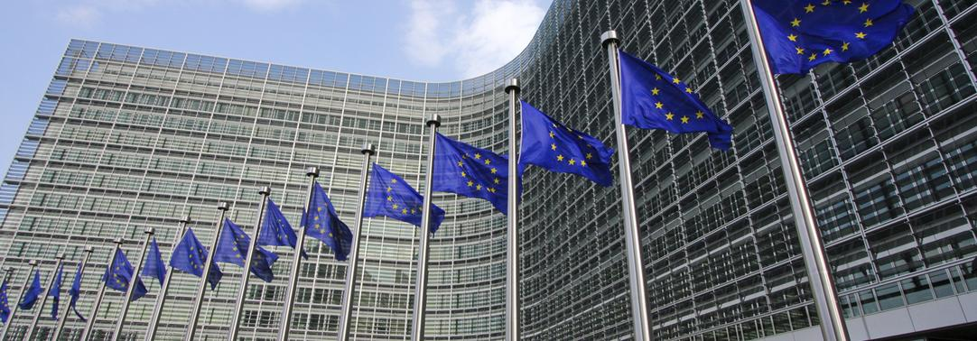 EU flags waiving in front of European Commission