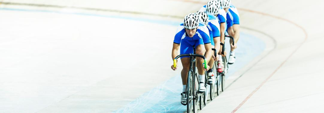Cyclists in a velodrome