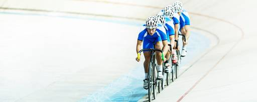 Competitive cyclists in a velodrome