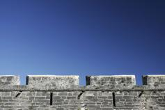 High wall castle beneath blue sky