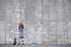 Little boy drawing rocket