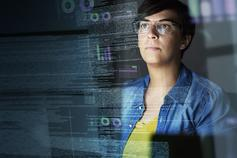 Overview of the International Information Integrity Institute (i-4) services - image of man looking at a seethrough screen
