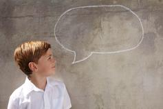 Boy looking at speech bubble