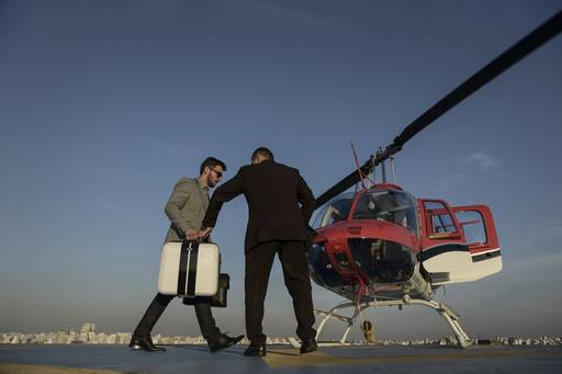Business man boarding helicopter