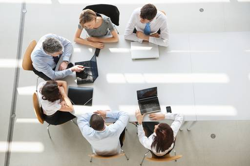 Office workers sitting a desk